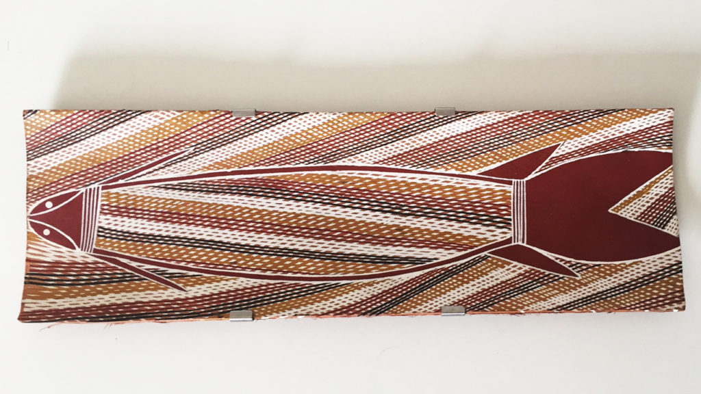 custom bark support made to suit the natural contours of the bark. Maningrida Arts and Culture, Arnhem Land